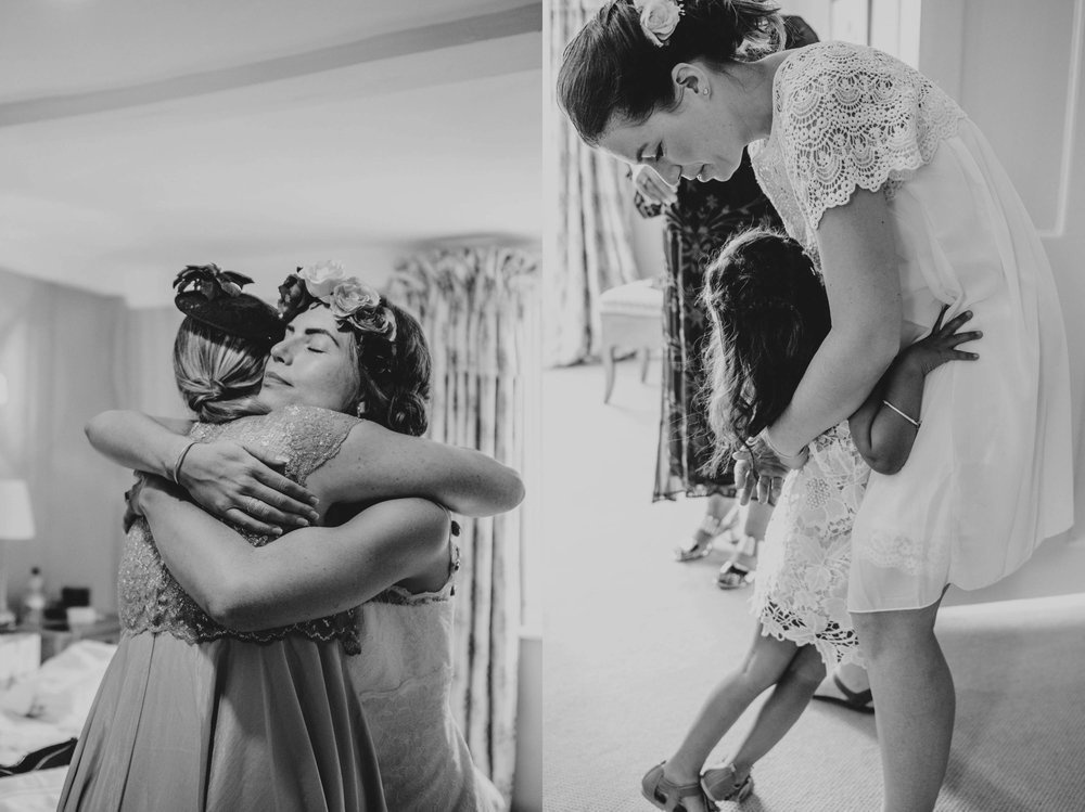 A Boho, Barefoot, DIY Wedding at Houchins, Essex. Bridesmaids in white with flower crowns, Groom in tweed with bowtie and Braces. Essex Documentary Wedding Photographer.