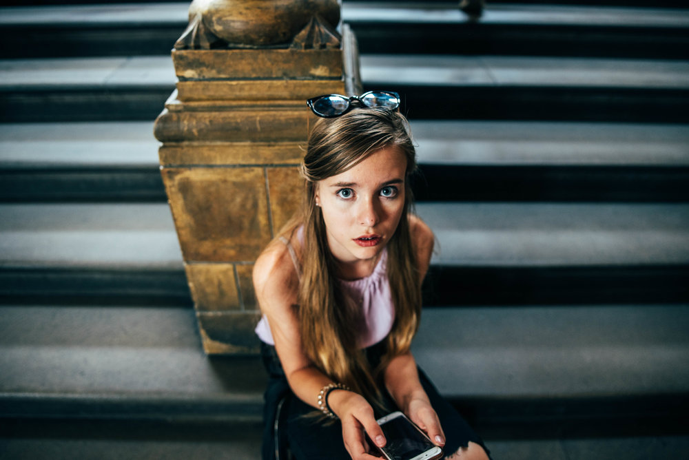 teen girl sits on steps at London Natural History Museum Essex UK Documentary Lifestyle Wedding Photographer