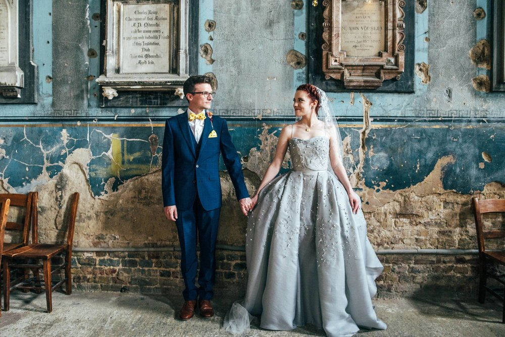 Alternative, quirky wedding at Asylum Chapel. Bridesmaids in Yellow, Bride wears Wilden London. Essex UK Documentary Wedding Photographer