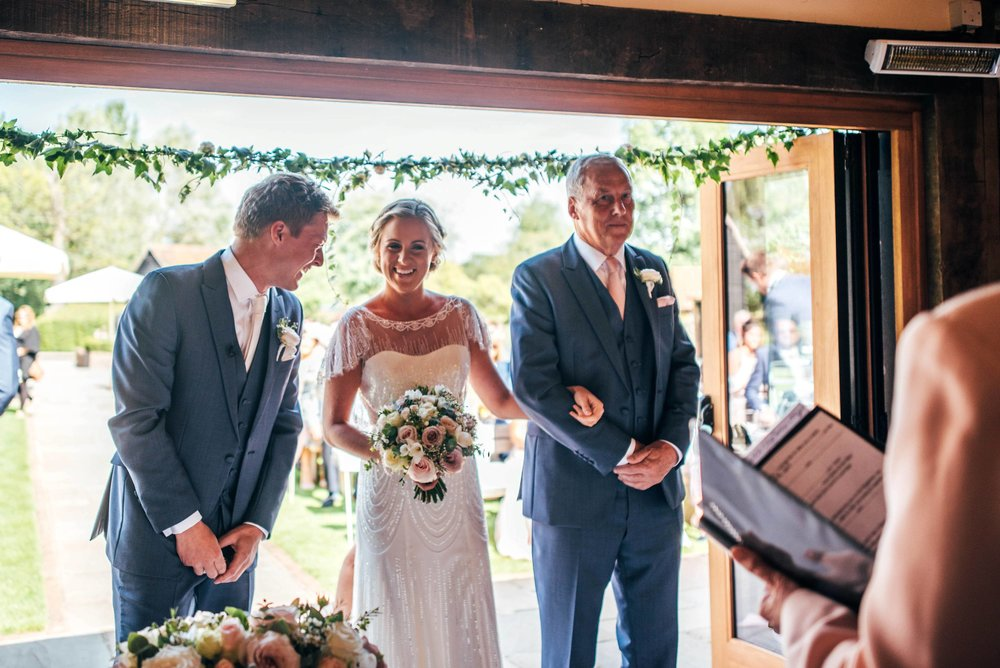 Blush pink rustic barn wedding with touch of elegance, Bride wears Jenny Packham Essex UK Documentary Wedding Photographer