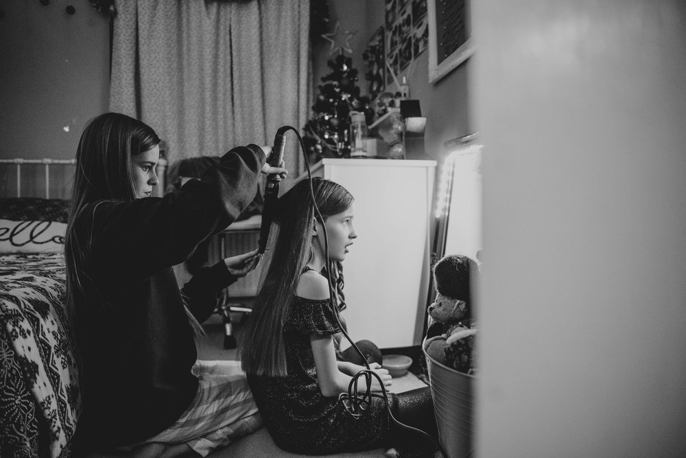 Tween sisters doing hair Essex UK Wedding Documentary Photographer