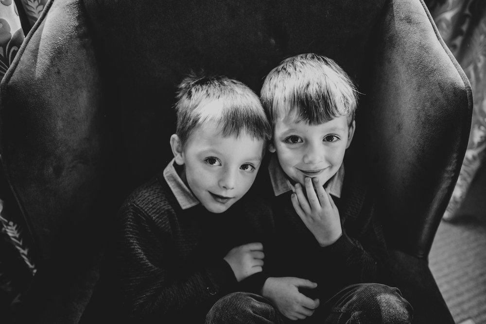 Brothers sit in big chair essex Documentary Portrait Photographer