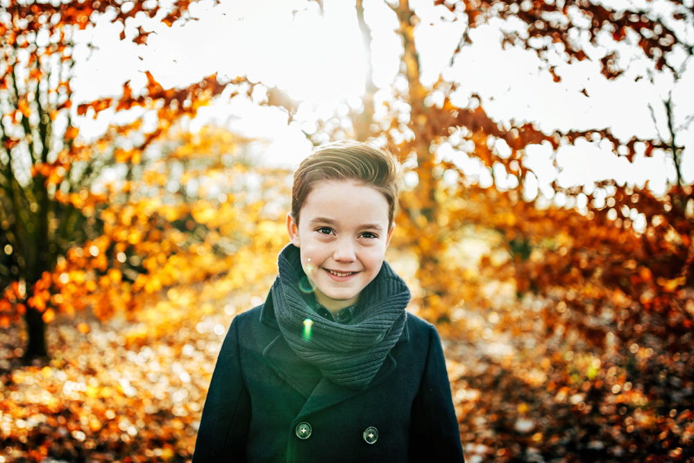 Boy in autumn wood Essex Documentary Portrait Photographer
