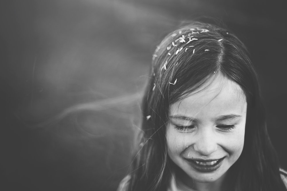 Little girl with daisies in her hair Essex Documentary Portrait Photographer