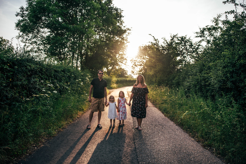 family walk down lane at sunset essex documentary portrait photographer