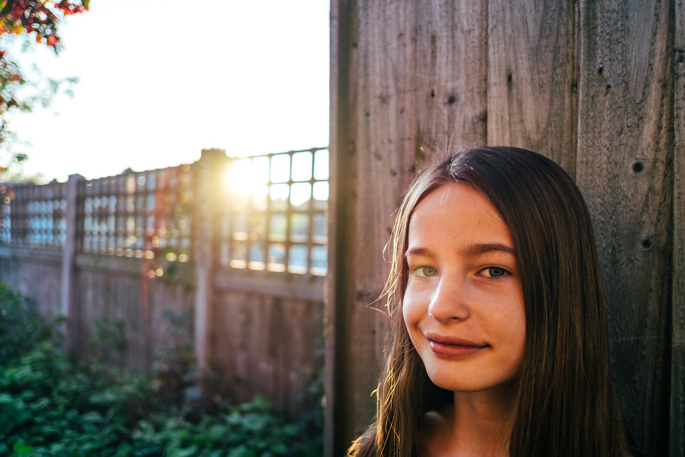 Tween girl in alleyway at sunset Essex Documentary Wedding and Family Photographer