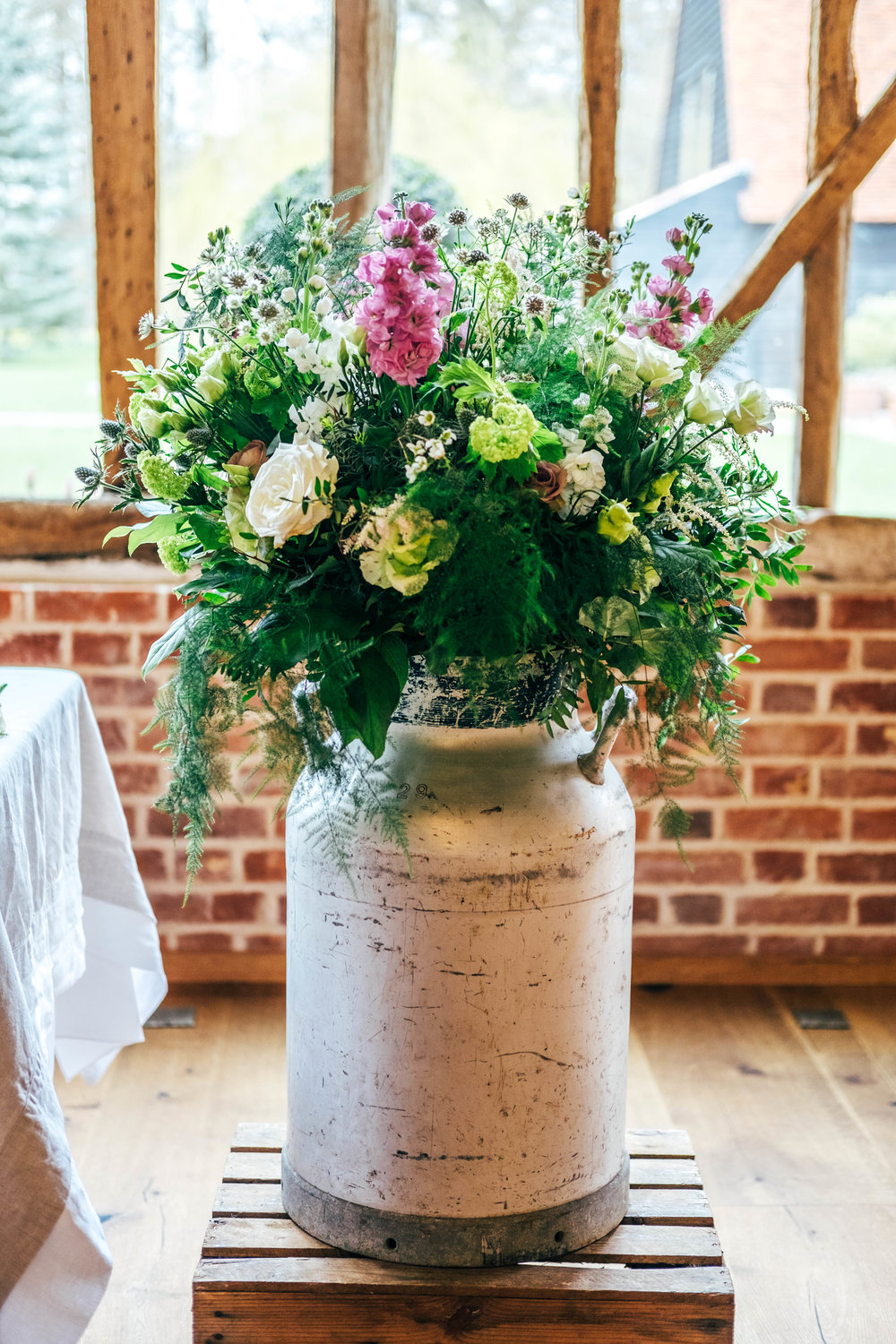 Rustic Blush Pink Spring Wedding with travel inspired table decor at Blake Hall Essex Documentary Wedding Photographer