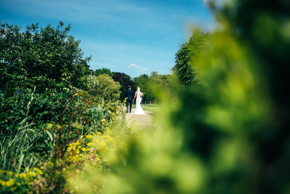Dove Grey & Greens with Classic Simplicity at Gaynes Park, Epping. Bride wears Pronovias. Essex Documentary Wedding Photographer