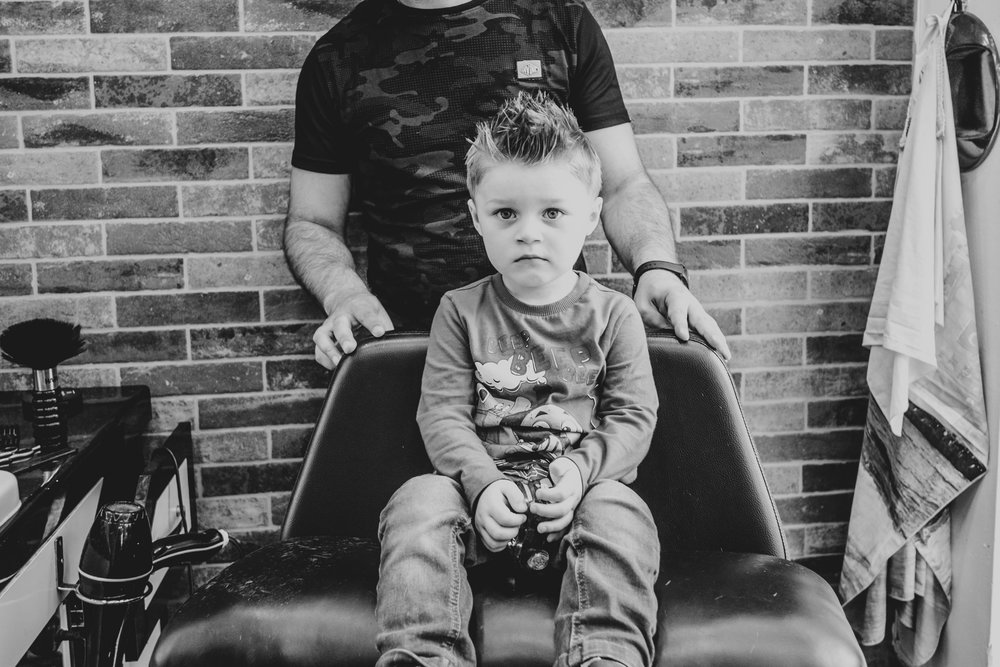 Little boy in hairdressers chair Essex Family and Wedding Documentary Photographer