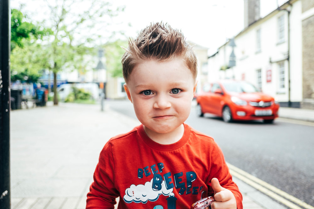 Little boy with red t shirt Essex Documentary Family and Wedding Photographer