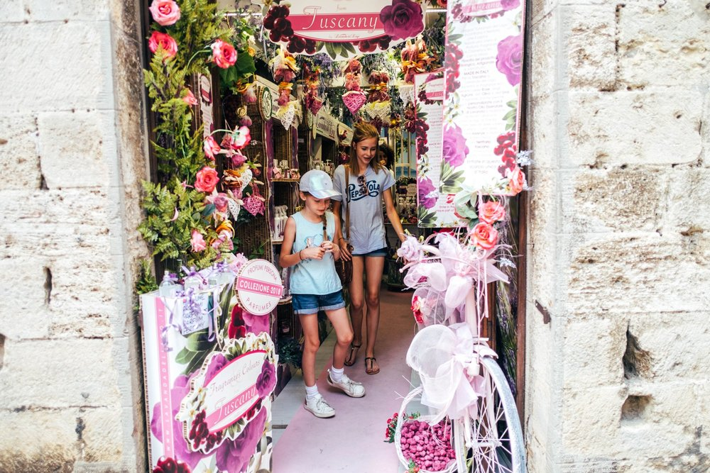 Girls in pink shop St Gimignano Tuscany Essex Documentary Travel Wedding Photographer