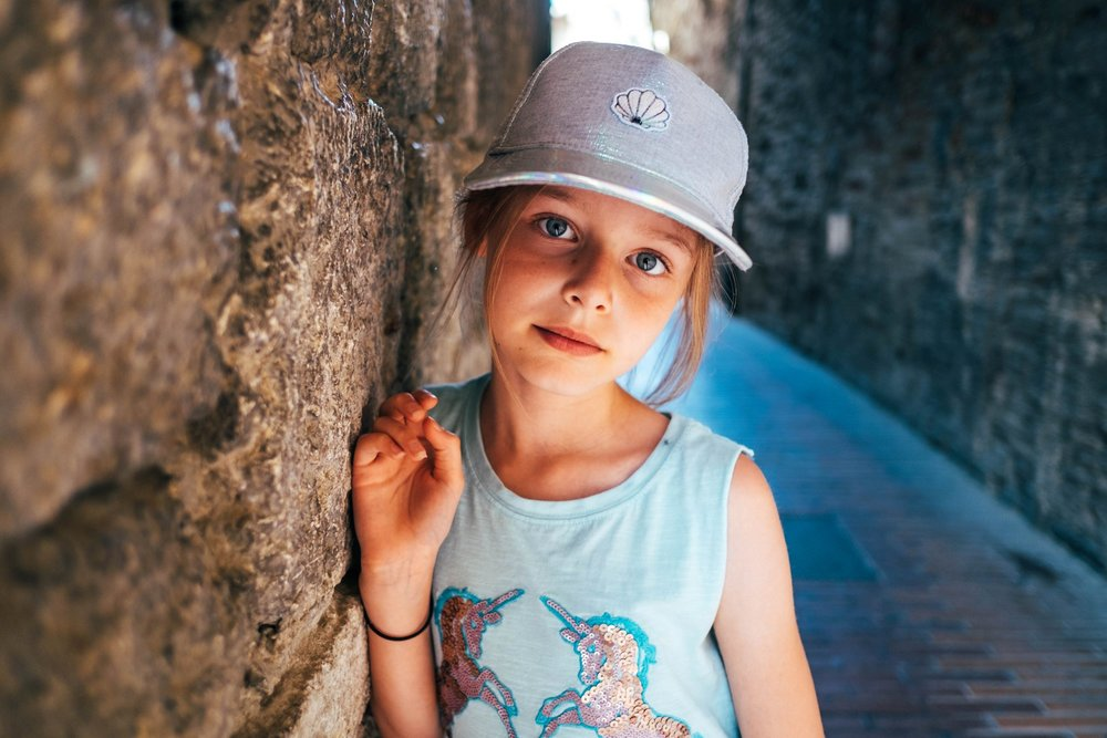 Little girl in alleyway St Gimignano Tuscany Essex Documentary Wedding Travel Photographer