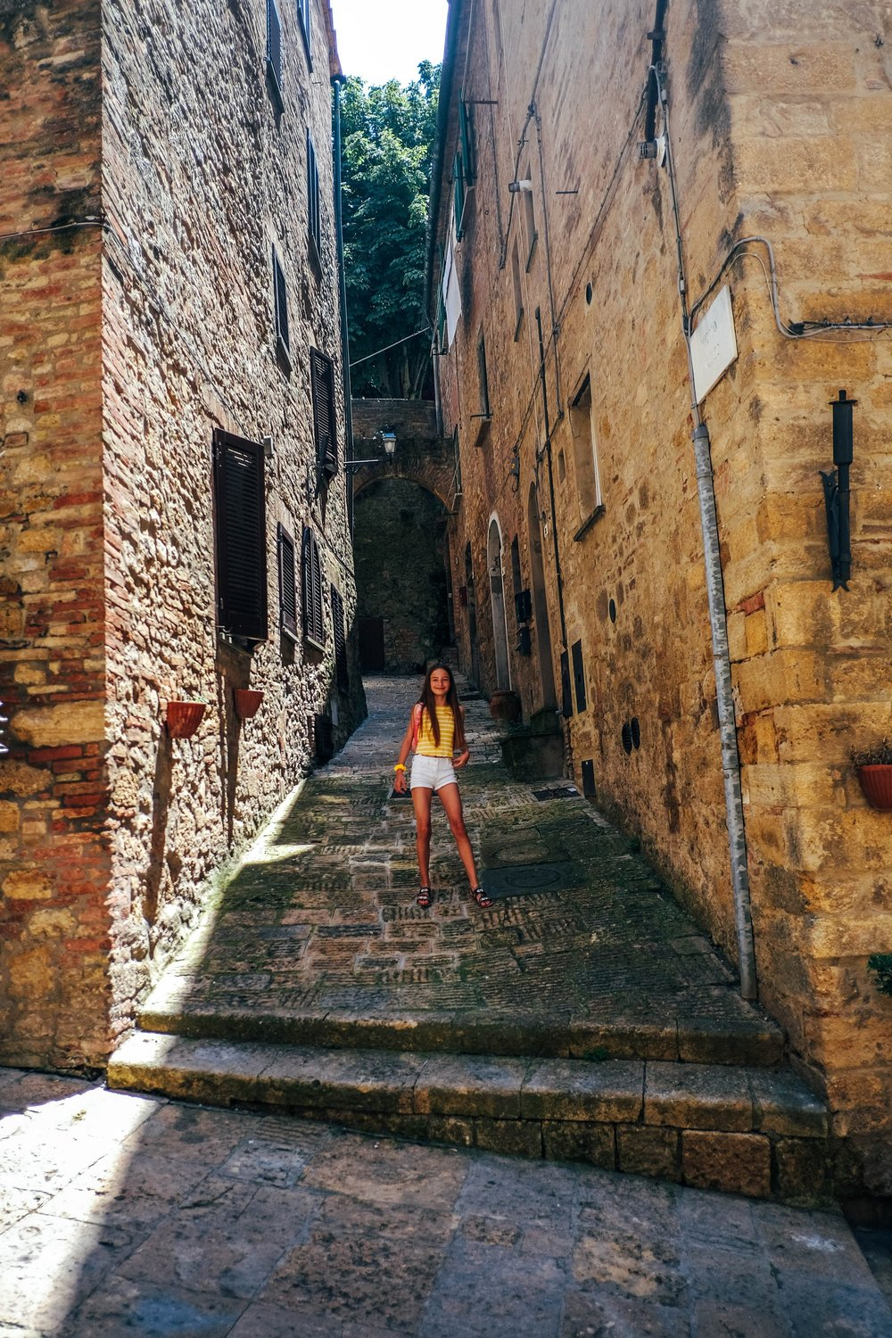 Girl on steep streets of Volterra Tuscany Essex Documentary Travel Family Photographer