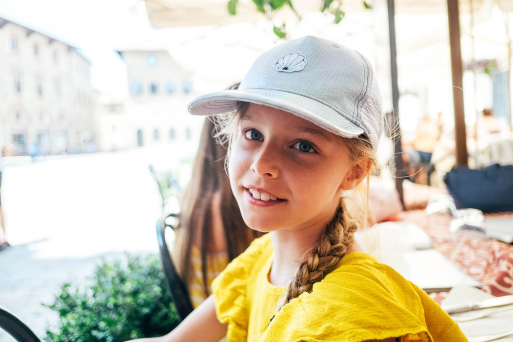 Little girl in Piazza dei Priori Volterra Essex Documentary Travel Photographer