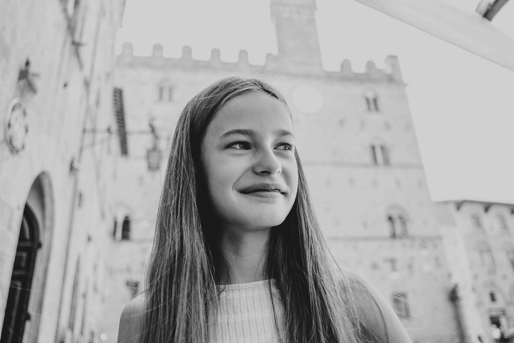 Tween girl in Piazza dei Priori Volterra Essex Documentary Travel Photographer