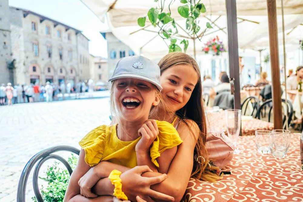 Two sisters in Piazza dei Priori Volterra Essex Documentary Travel Family Photographer