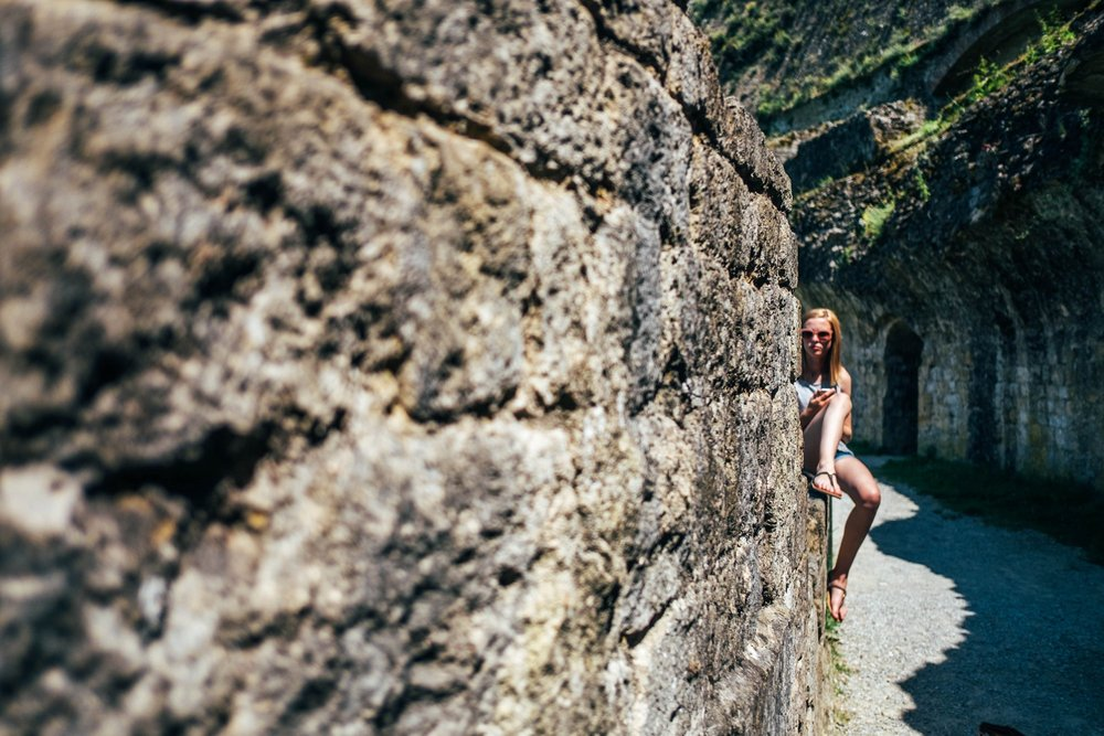 Teen girl on wall Roman ruins Volterra Essex Documentary Travel Family Photographer
