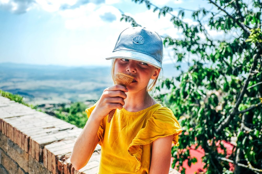 Little girl eats Ice Cream Volterra Tuscany Essex Documentary Travel Family Photographer