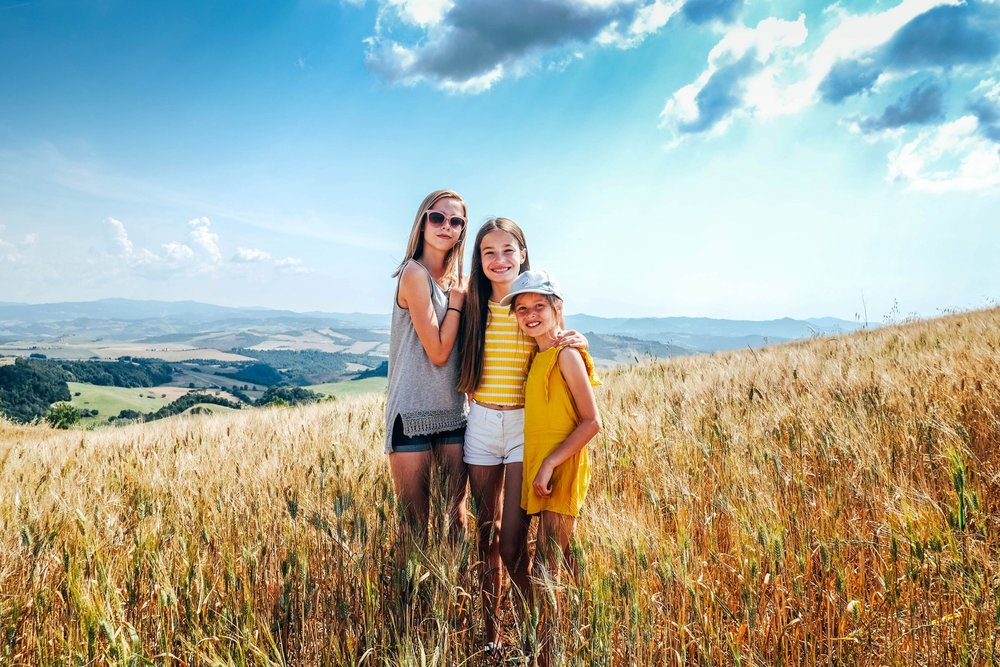 Three sisters in cornfield Volterra Tuscany Essex Documentary travel family photographer