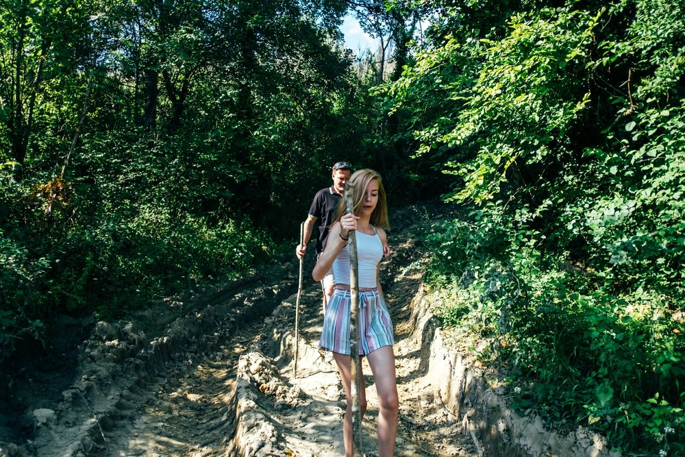Dad and daughter on hillside walk in Tuscany Essex documentary travel family photographer