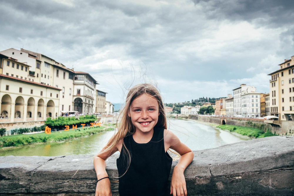 Young girl stands on the Ponte Vecchio Florence Italy Essex Documentary Family Wedding Photographer