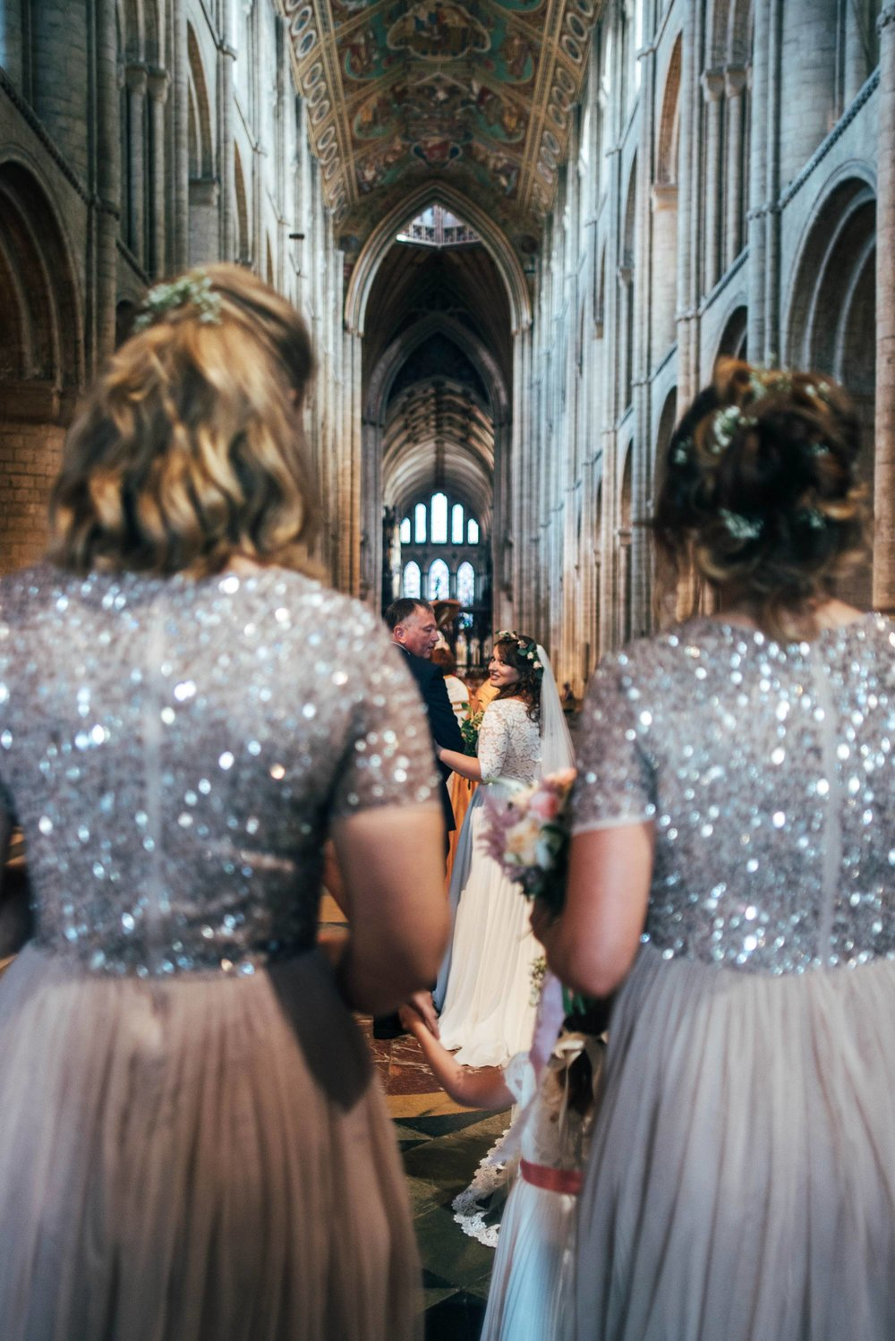 Ely Cathedral with a DIY, Boho Farm Wedding Reception at Bedingham's Farm , Bride wears Willowby by Watters and a Flower Crown. Essex Documentary Wedding Photographer