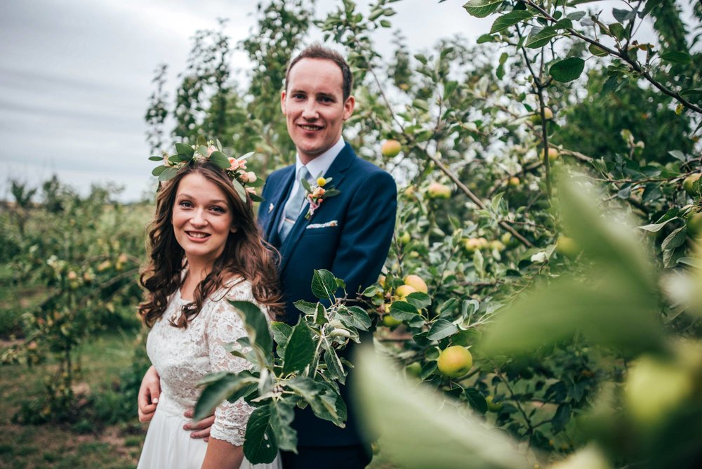 Ely Cathedral with a DIY, Boho Farm Wedding Reception at Bedingham's Farm , Bride wears Willowby by Watters and a Flower Crown. Essex Documentary Wedding Photographer.