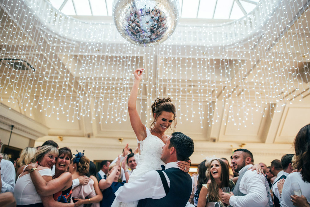 Groom holds his Bride in the air during first dance at Stock Brook Manor, Billericay Essex Documentary Wedding Photographer