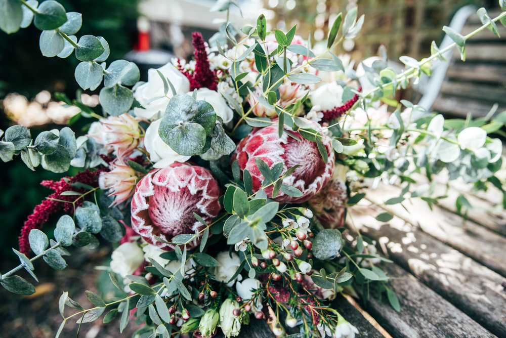 Red Proteus with Eucalyptus Bouquet Essex Documentary Wedding Photographer