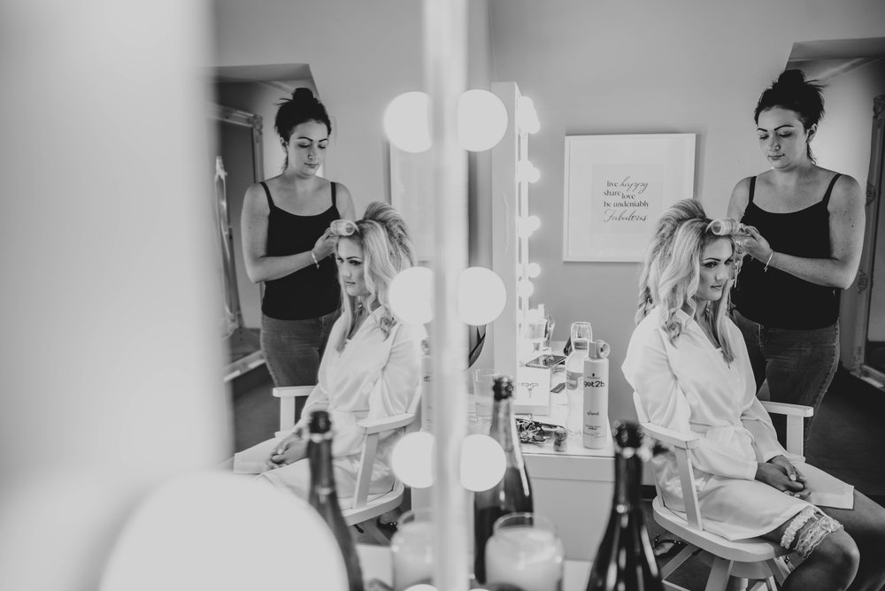 Bridal Prep in dressing rooms at Parklands, Quendon Hall Essex Documentary Wedding Photographer