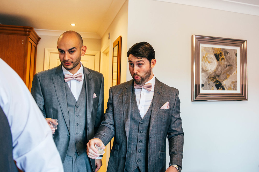 Groom pulls face after pre wedding shot Blake Hall Ongar, Essex Documentary Wedding Photographer