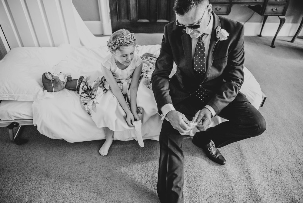 Wedding guest and Flower girl put on socks Ashdown Park Hotel, Essex Documentary Wedding Photographer