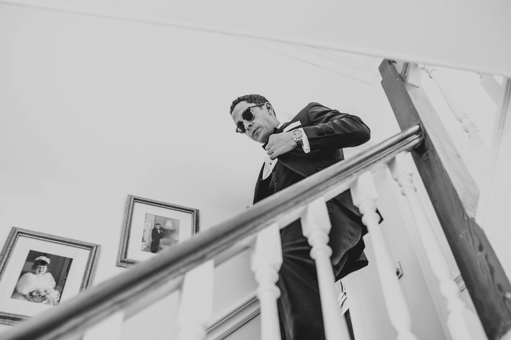 Groom comes downstairs Essex Documentary wedding Photographer
