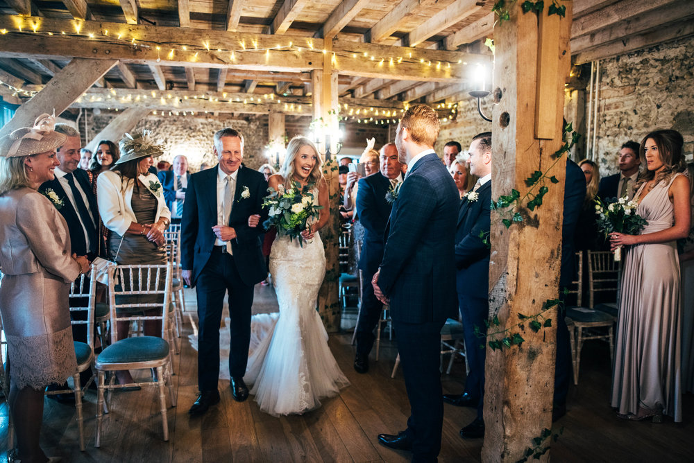 Bride walks down aisle at The Granary Estates, Woodditton in Autumn Wedding Essex Documentary Wedding Photographer