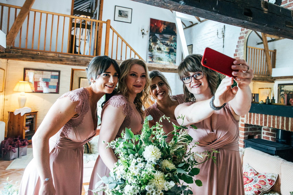 Bridesmaids take selfie at Ratsbury Barn, Essex Documentary Wedding Photographer