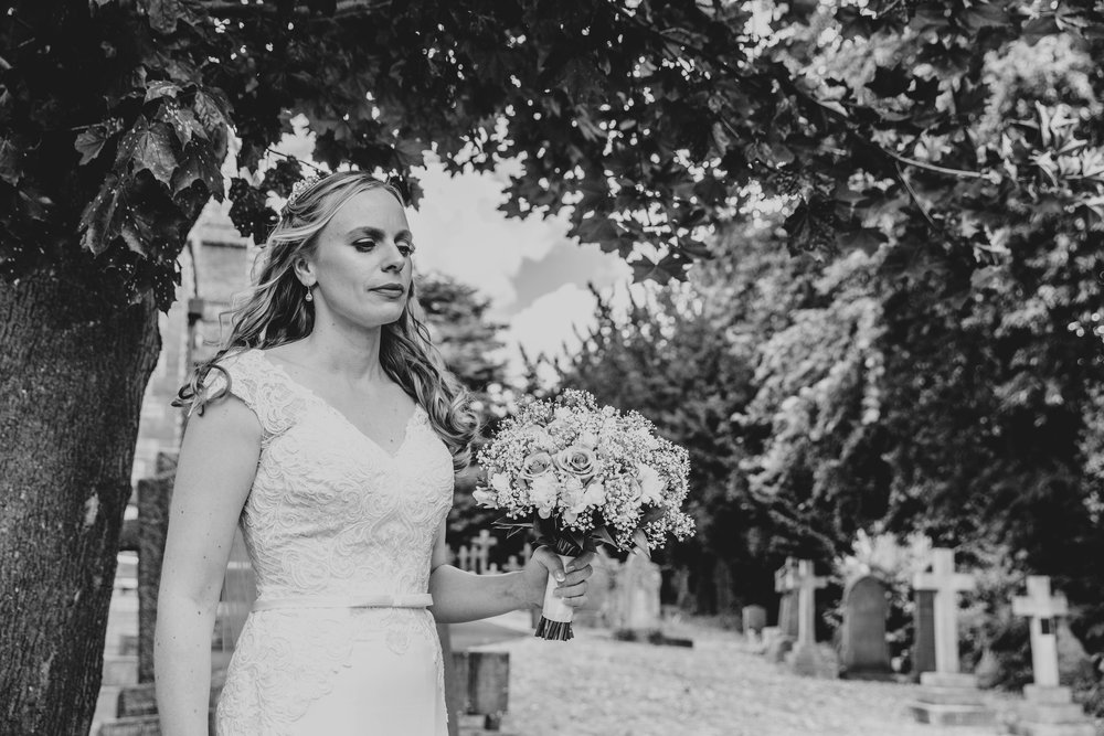 Bride takes a moment of contemplation before ceremony, Essex Documentary Wedding Photographer