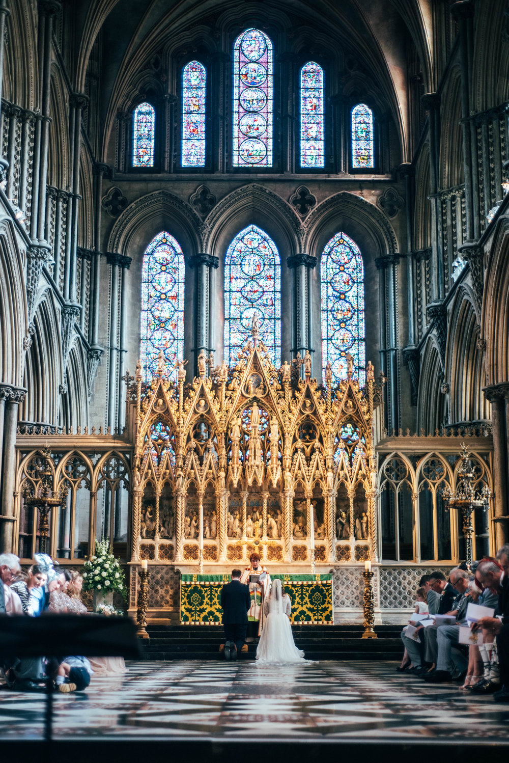 Bride and Groom during ceremony at Ely Cathedral, Essex Documentary Wedding Photographer