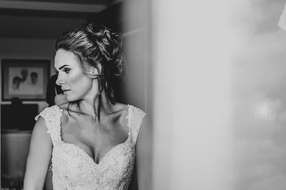 Bride has dress done up at Stock Brook Manor, Billericay, Essex Documentary Wedding Photographer