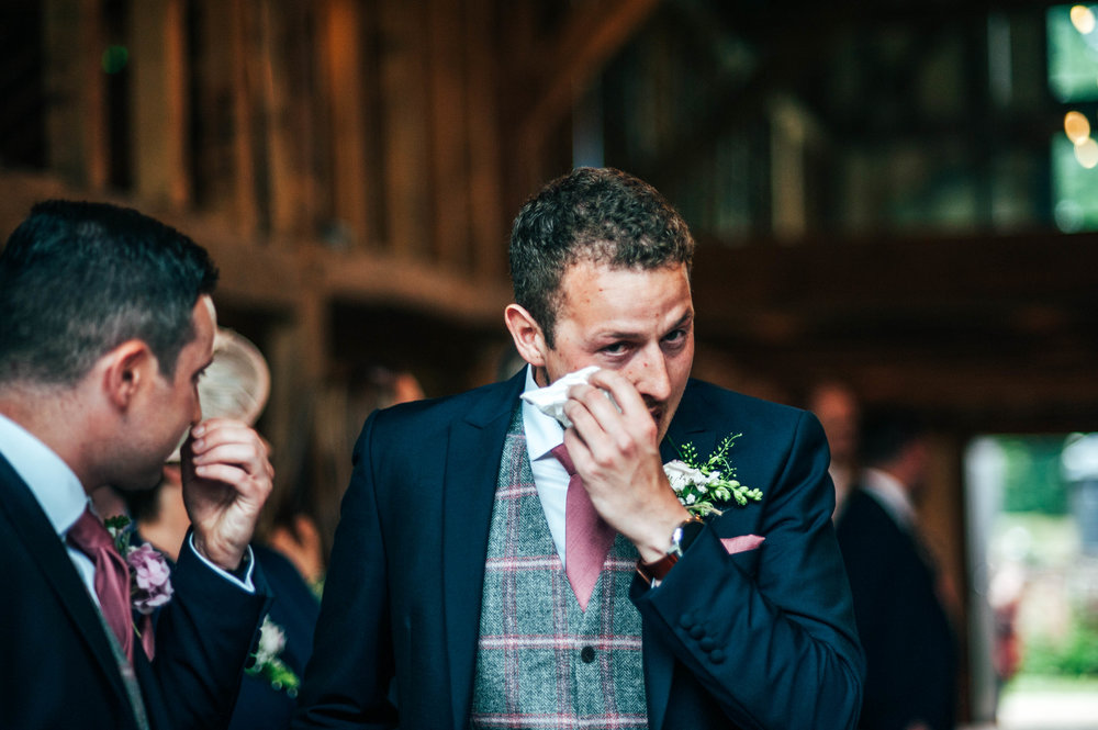 Groom wipes away tear as Bride enters, Blake Hall, Ongar Essex Documentary Wedding Photographer