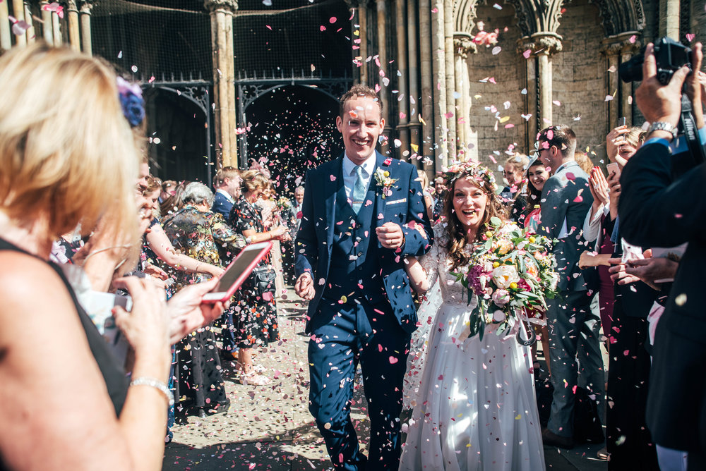 Confetti for Bride and Groom at Ely Cathedral, Essex Documentary Wedding Photographer