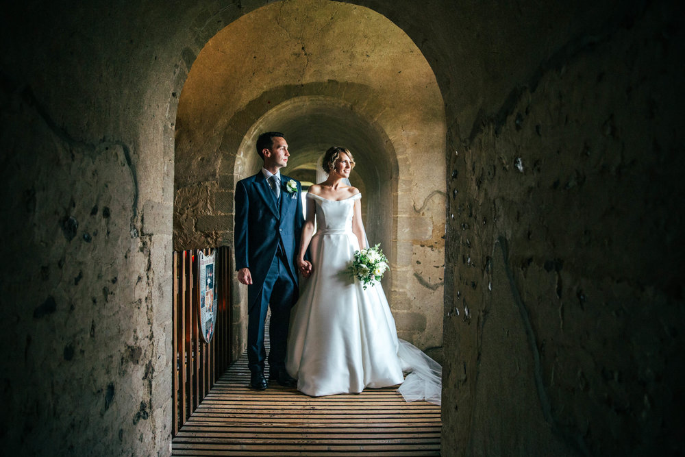 Bride and Groom at Hedingham Castle.  Essex Documentary Wedding Photographer