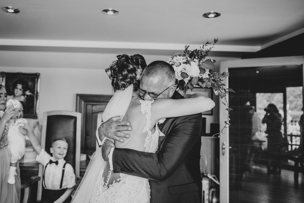 Emotional Father of Bride hugs Bride at Stock Brook Manor, Billericay.  Essex Documentary Wedding Photographer