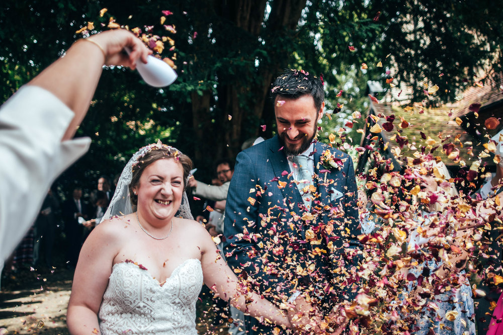 Bride and Groom and lots of confetti for Anglian Railway Museum Wedding, Essex Documentary Wedding Photographer