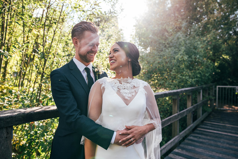Bride and Groom in Autumn Sun at Mile End Ecology Pavilion. Essex Documentary Wedding Photographer