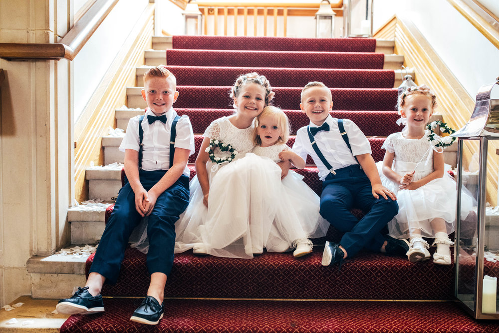 Flower girls and Page boys on stairs at Stock Brook Manor, Billericay.  Essex Documentary Wedding Photographer