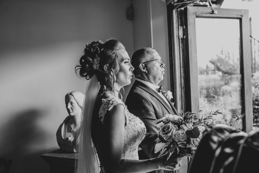 Nervous Bride with her Dad right before Ceremony at Stock Brook Manor, Billericay Essex Documentary Wedding Photographer