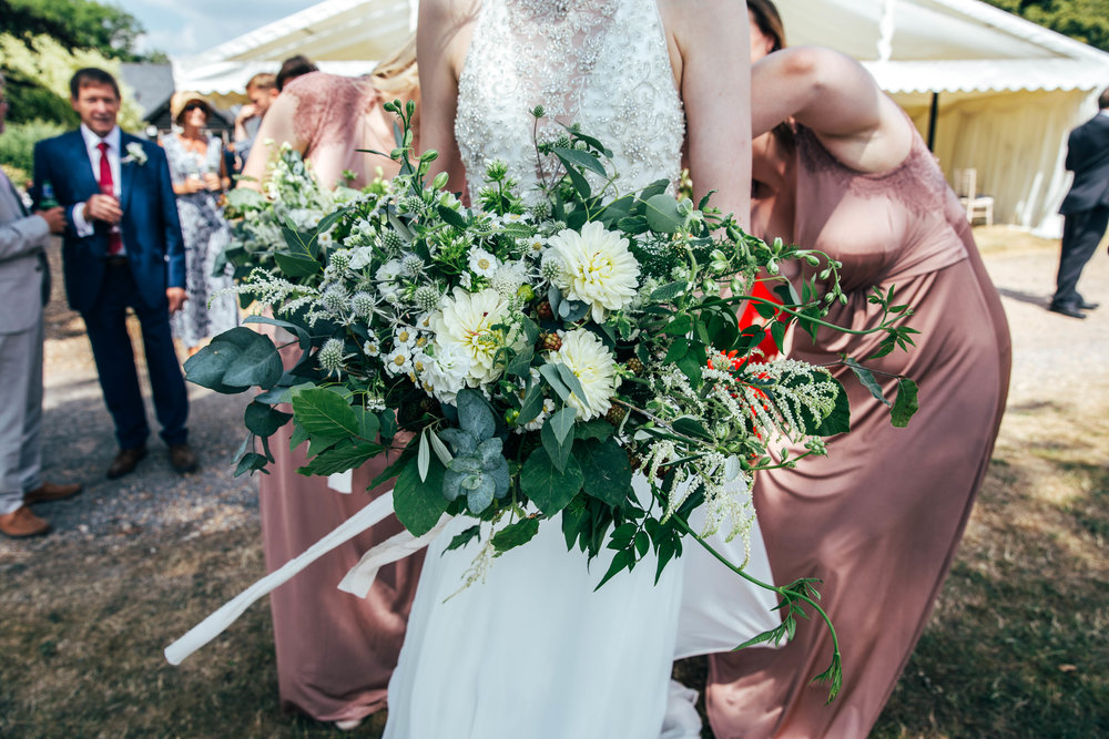 Trailing wild bouquet.  Essex Documentary Wedding Photographer