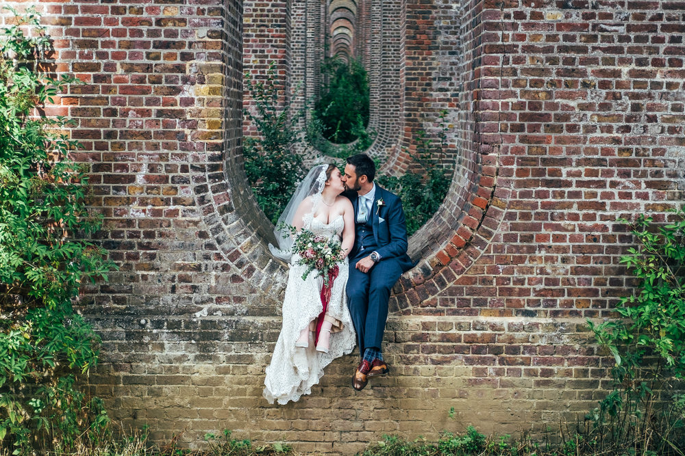 Bride & Groom in Viaduct at Chappel for East Anglian Railway Museum Wedding Essex Documentary Wedding Photographer