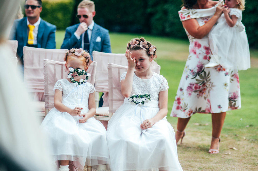Flower Girl cries during ceremony at Stock Brook Manor, Billericay.  Essex Documentary Wedding Photography