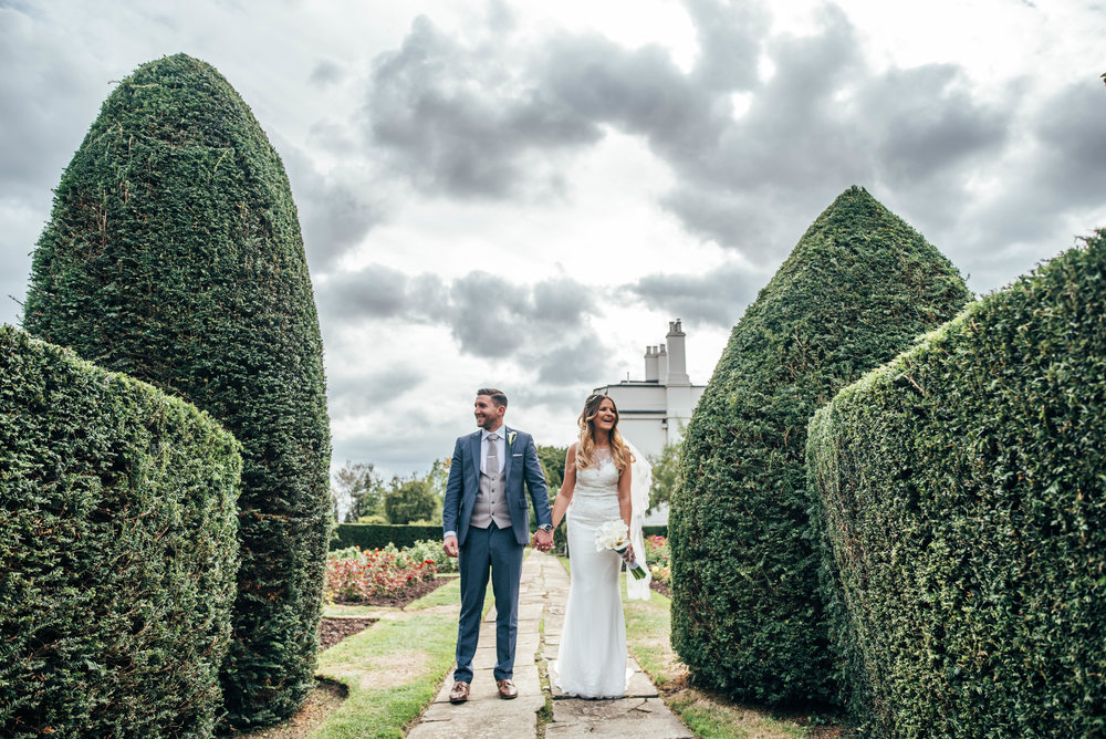 Bride and Groom in gardens at Blake Hall, Ongar Essex Documentary Wedding Photographer
